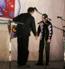 Александр Широких получает гитару от А.Волкова, как самый работящий член оргкомитета