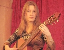 Портрет девушки с гитарой