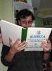 В.Тиунов читает книгу восторженных отзывов и мат. предложений